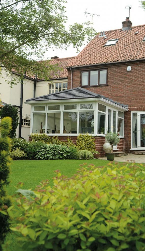 Conservatory with replacement tiled roof